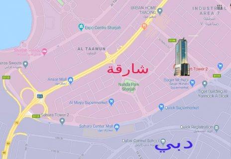 برج سكني ذا موقع استراتيجي بمنطقة النهدة الخط الفاصل مع إمارة دبي