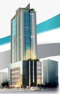 برج سكني ذا موقع استراتيجي بمنطقة النهدة الخط الفاصل مع إمارة دبي .