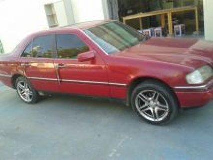 سيارة مرسيدس C280 لون احمر للبيع