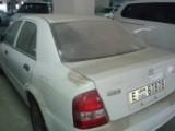 سيارة بحالة جيدة  لون ابيض مازدا 323 موديل2002